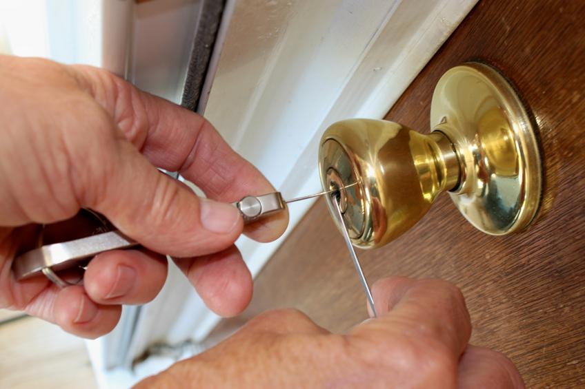 Locksmith unlocking a door.